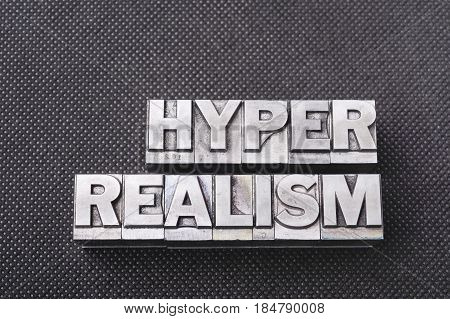 hyper realism phrase made from metallic letterpress blocks on black perforated surface poster