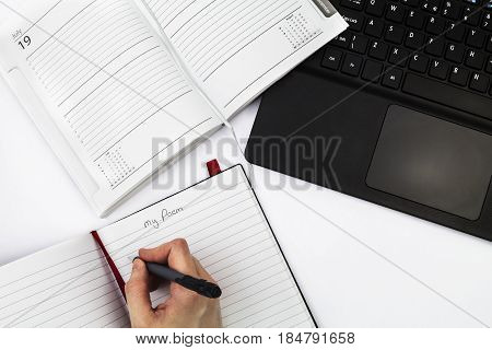 Office worker writing a poem at a desk