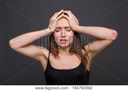 Emotional woman desperate, facial expressions, stressed girl on dark background