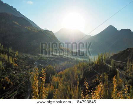 Landscape Of Golden Autumn In Hunza Valley And Altit Fort With Surrounding Mist, Karimabad, Gilgit-Baltistan Region Of Pakistan