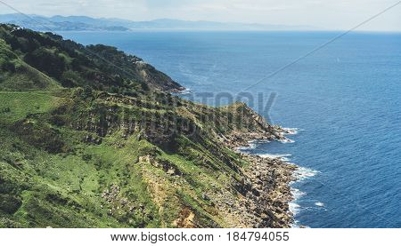 Sunset in mountain natura perspective landscape. Green valley island on background blue sky clouds sea ocean. Panorama horizon perspective view of scenery hills Northern Spain alps. Travel mockup concept