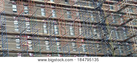skyscraper scaffold panorama building construction site renovation high facade windows