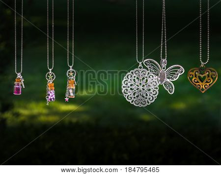 hanging pendant necklace green background steel material poster