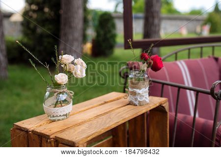 Beautiful Wedding Ceremony Outdoors. Decorated Chairs Stand On The Grass. Wedding Arch Made  Flowers