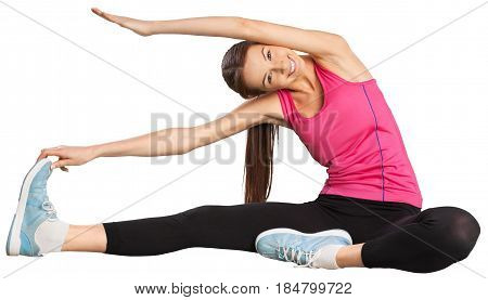 Smiling woman with high body flexibility exercising in the gym - isolated image