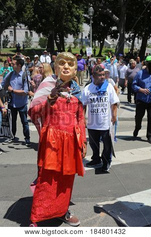 LOS ANGELES California- May 1, 2017: May Day People Wave Signs, Wear Costumes, Yell, Demand Change at a Protest Rally Against President Donald J. Trump on May 1, 2017 in Los Angeles, California