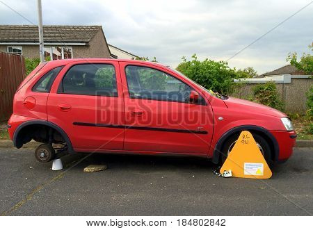 Bracknell, England - May 04, 2017: Car fitted with a wheel clamp for non-payment of vehicle road tax in England