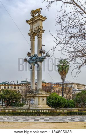 Monument to Columbus which consists of the caravel Santa Maria between two towering white columns with a lion on top Seville Spain