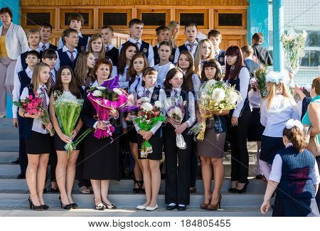 Voronezh Russia - September 02 2013: High school students with a teacher on the eve of the school on Knowledge Day September 1 in Russia