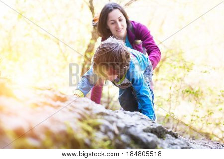 The Child Climbs On The Boulder.