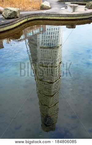 MALMO SWEDEN - MARCH 07 2017: Reflection of Malmo Turning Torso Swedish city landmark is the tallest building in Sweden and whole Scandinavia measuring 190 meters (623 feet).