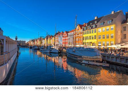 COPENHAGEN DENMARK - MARCH 11 2017: Copenhagen Nyhavn district. In 1977 Nyhavn was inaugurated as a veteran ship and museum harbour by Copenhagen's Lord Mayor Egon Weidekamp