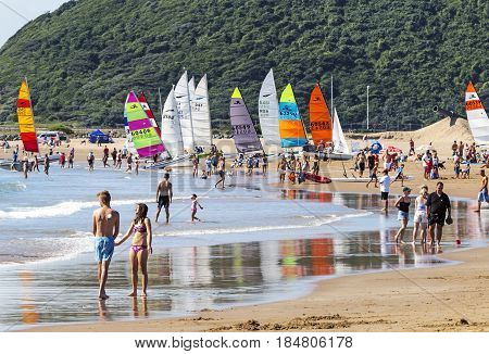 People And Colorful Yachts On Beach In Durban