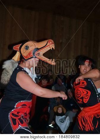 Metlakatla, Alaska - July 26, 2008;  Indigenous locals performing indoors for group of tourists at small village on Inside Passage Metlakatla Alaska.