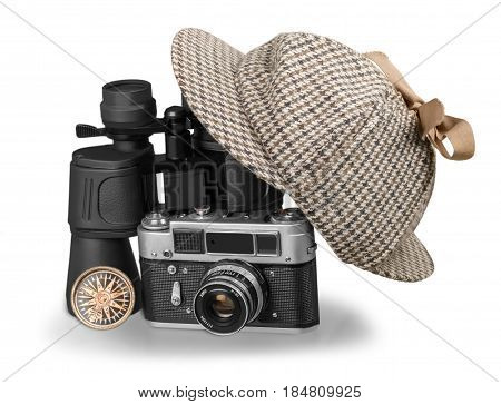 Black binoculars, Sherlock Holmes hat, Camera and Compass Isolated on White Background