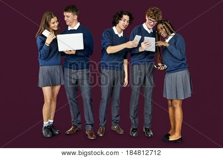 Group of Diverse Students Using Digital Devices Studio Portrait