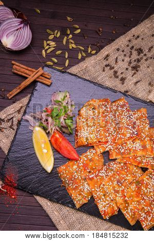 The Arab spicy flat cake with forcemeat from mutton and sesame powder