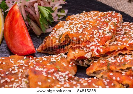 Spicy flat cake with forcemeat from mutton and sesame powder
