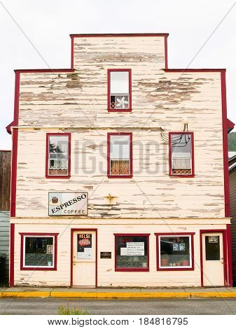 Petersburg, Alaska, USA - July 27, 2008; Old building facade in need of repaint and maintenance with Espresso coffee sign.