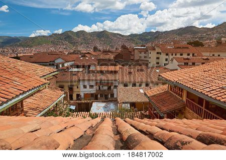 Cityscape of cusco city in Peu. Red roofs in cusco tourist city