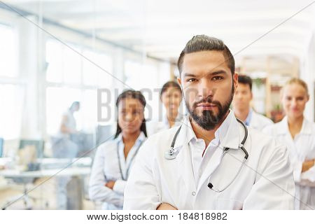 Self confident boss with team of doctors showing athority and competence