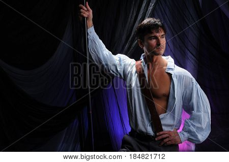 The sexy man is holding up his arm