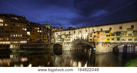 sunset above Ponte Vecchio - Old Bridge view from Arno river bank