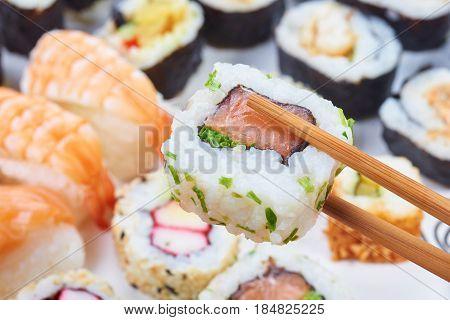 Sushi set. Chopsticks with portion of sushi