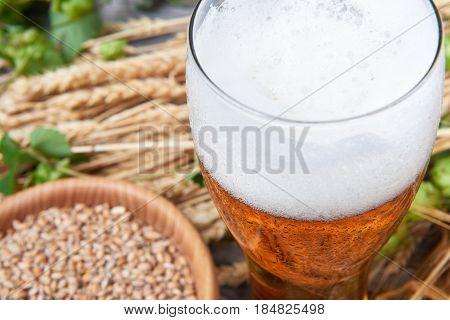 Cold wheat bear in glass on the wooden table