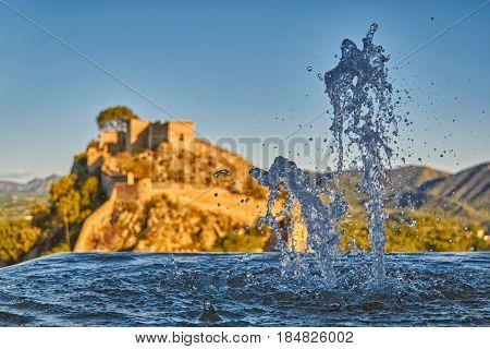 Beautiful Splashing fountain in Xativa Castle of Spain at Sunset