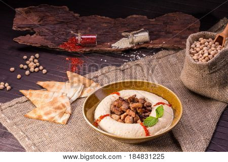 The wiped chick-pea with sesame paste and the most delicate pieces of the fried veal