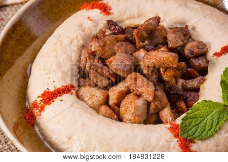 The chick-pea wiped with sesame paste with the most delicate pieces of the fried veal