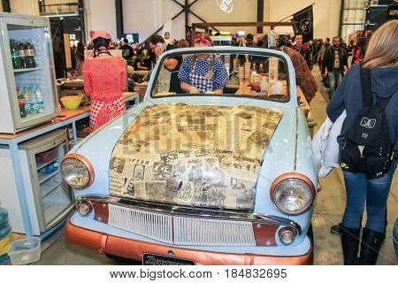 St. Petersburg Russia - 15 April, An improvised cafe from a retro car,15 April, 2017. International Motor Show IMIS-2017 in Expoforurum. Visitors and participants of the annual moto-salon in St. Petersburg.