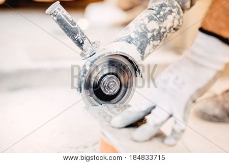 Close Up Of Industrial Tool, Grinder Cutting Piece Of Stone. Marble Cutting At Construction Site..