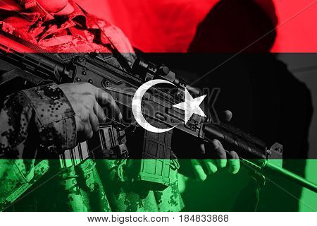 Soldier With Machine Gun With National Flag Of Libya