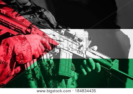 Soldier With Machine Gun With National Flag Of Palestine
