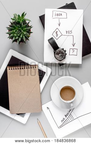 business plan with tablet, chart and copybook in management set on gray office table background top view mockup