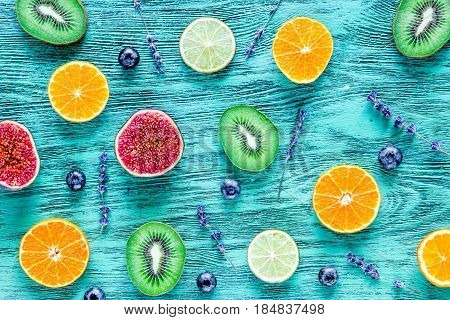 colofrul fruit design with citrus and kiwi on blue rustic desk background top view pattern