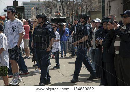 BRONX NEW YORK USA - APRIL 10: NYPD PoliceCounter terrorism Bureau officers patrol Yankee stadium during opening day game. Taken April 10 2017 in New York.