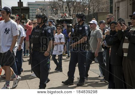 BRONX NEW YORK USA - APRIL 10: NYPD Police Counter terrorism Bureau officers patrol Yankee stadium during opening day game. Taken April 10 2017 in New York.