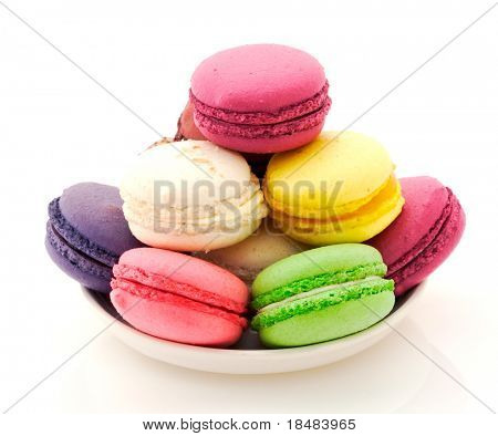 Plate of French macaroons on white background
