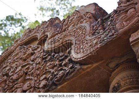 Detail carving in Banteay Srei Temple in Cambodia.