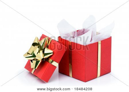 An opened red Christmas present box with a golden bow