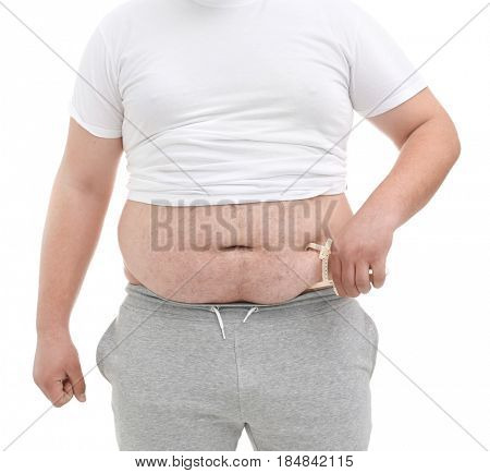 Fat man with measuring caliper on white background, closeup. Weight loss concept