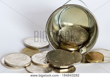Australian gold and silver coins with a bucket.
