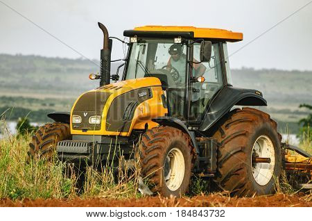 Tractor Plowing And Preparing The Soil