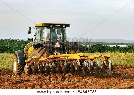 Tractor Plowing And Preparing The Soil.