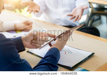 Business team present. Photo professional investor working new startup business project. Finance business meeting. Digital tablet laptop computer smart phone using.