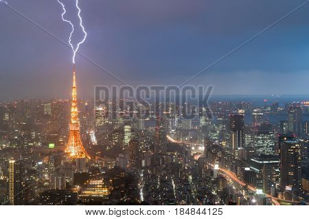 Lightning storm over Tokyo city Japan in night with thunderbolt over Tokyo tower. Thunderstorm in Tokyo Japan.