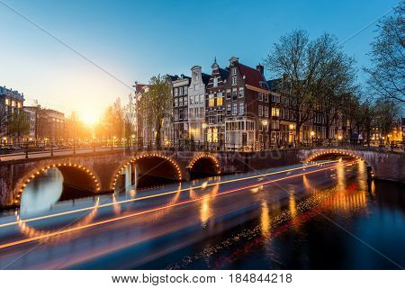 Canals of Amsterdam at night. Amsterdam is the capital and most populous city of the Netherlands.
